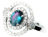 Captivating  .60 ct Brazilian 6.47 x 4.91 mm Oval Shape Alexandrite Ring With a Double . 36ct Diamond Frame