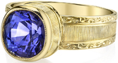 Intricate Hand Carved 18kt Yellow Gold Bezel Set Solitaire Ring With 2.49ct Round Tanzanite Gem