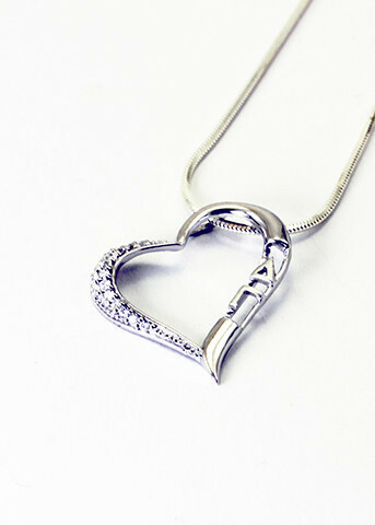 Sterling silver heart pendant set with lab-created diamonds