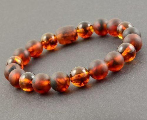 Mens Beaded Bracelet Made of Black Matte Baltic Amber