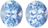 Fiery Aquamarine Matching Gemstone Pair in Oval Cut, 7.32 carats, Vivid Rich Blue, 11.2 x 9.2 mm