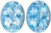 Lively Aquamarine Matching Gemstone Pair in Oval Cut, 9.56 carats, Medium Dark Blue, 12.7 x 9.8 mm