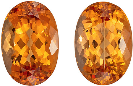 Pair of Imperial Topaz Gemstons in Oval Cut in a Peach Golden Color in 7.46 carats , 10.9 x 7.5 mm