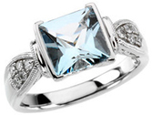 14KT White Gold Aquamarine & 1/8 Carat Total Weight Diamond Ring
