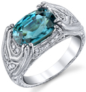 Intricate Hand Carved 18kt White Gold Ring With 8x11mm Oval Blue Zircon - Diamond Accents