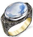 So Striking Hand Made 6 carat Rainbow Moonstone Hand Engraved Yellow & White Gold Ring With Leaf Detail